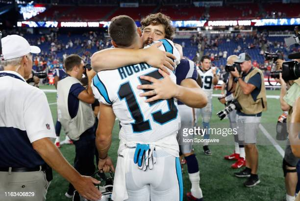 New England Patriots center David Andrews hugs former teammate Carolina Panthers wide receiver Chris Hogan after a preseason game between the New...