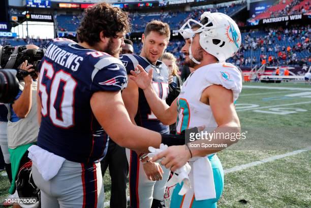 New England Patriots center David Andrews New England Patriots wide receiver Chris Hogan and Miami Dolphins wide receiver Danny Amendola after a game...