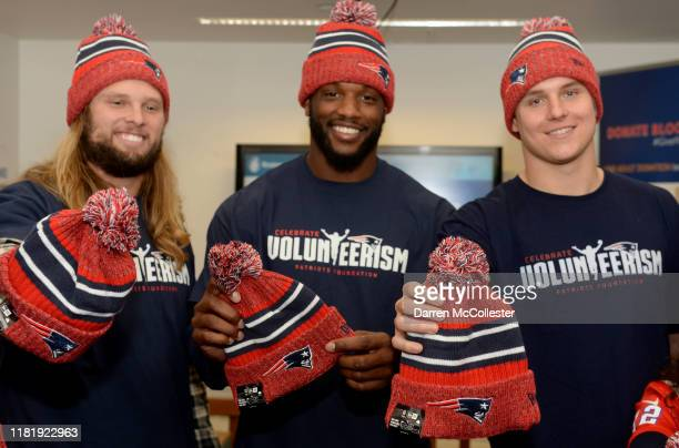 New England Patriots Chase Winovich, Shilique Calhoun, and Ryan Izzo, hold hats that were delivered to the kids at Boston Children's Hospital...