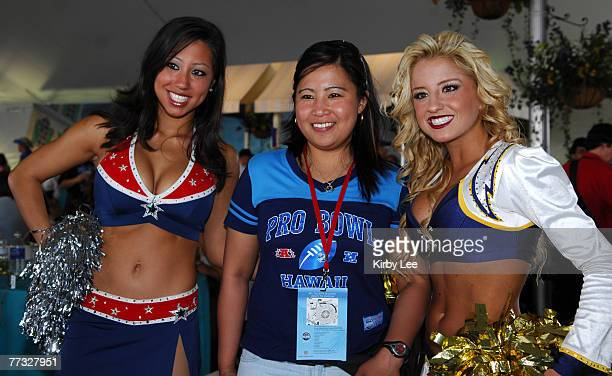 New England Patriots cheerleader Briana Lee and San Diego Charger Girl cheerleader Stacie Gazonas pose with a female fan at the NFL Pro Bowl Tailgate...