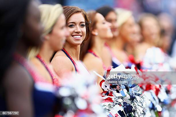 New England Patriots cheerleader looks on before the game between the New England Patriots and the Miami Dolphins at Gillette Stadium on September 18...