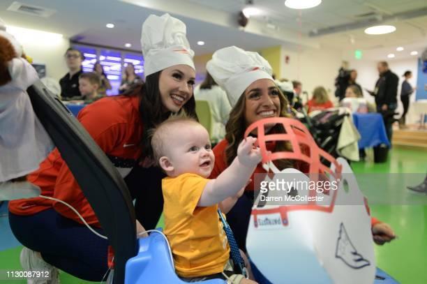 New England Patriot's cheerleaders Caitlin and Vanessa visit with Hezekiah at Boston Children's Hospital March 12 2019 in Boston Massachusetts