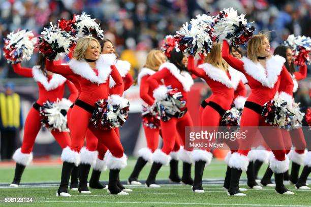 New England Patriots cheerleaders perform during the first half of the game between the New England Patriots and the Buffalo Bills at Gillette...