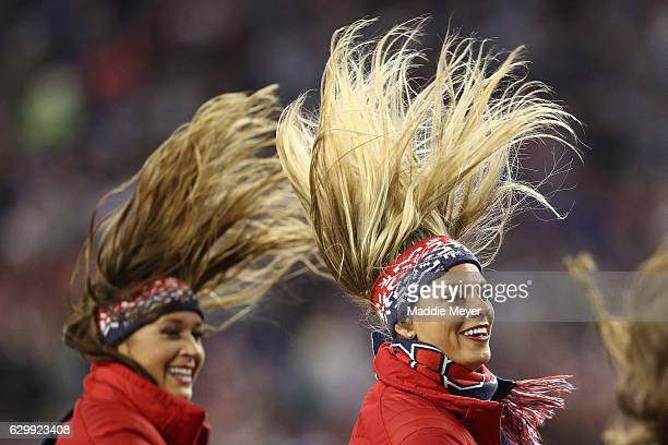 New England Patriots cheerleaders perform during the game between the New England Patriots and the Baltimore Ravens at Gillette Stadium on December...