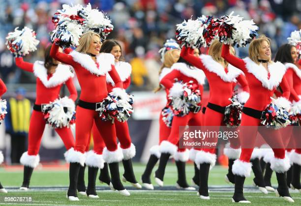 New England Patriots cheerleaders perform wearing holiday outfits during a game against the Buffalo Bills at Gillette Stadium on December 24 2017 in...