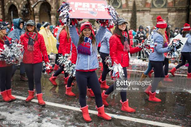 New England Patriots cheerleaders walk down Boylston Street during the Patriots victory parade on February 7 2017 in Boston Massachusetts The...