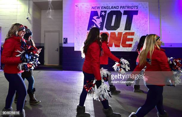 New England Patriots cheerleaders walk through the tunnel before the AFC Divisional Playoff game against the Tennessee Titans at Gillette Stadium on...