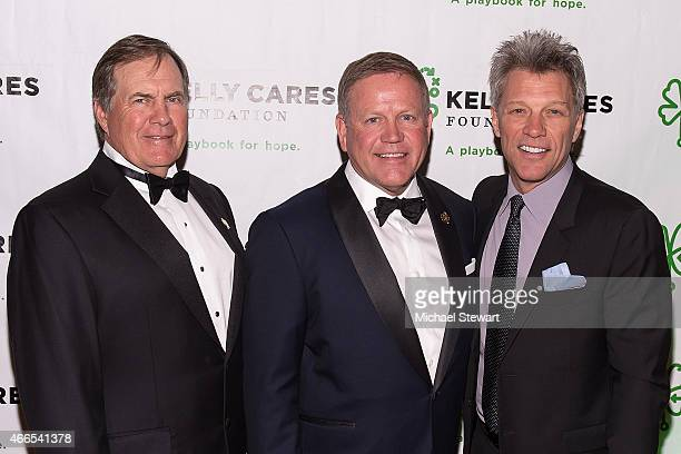New England Patriots coach Bill Belichick University of Notre Dame football coach Brian Kelly and musician Jon Bon Jovi attend the 5th Annual Irish...