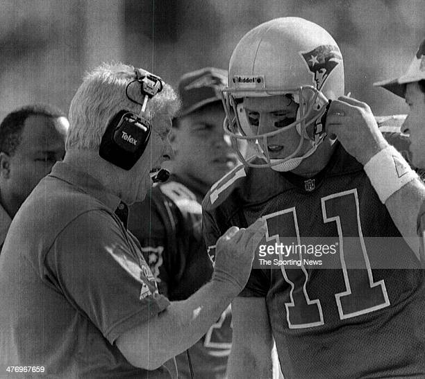 New England Patriots coach Bill Parcells talks to quarterback Drew Bledsoe during a timeout late in the fourth quarter against the Detroit Lions...