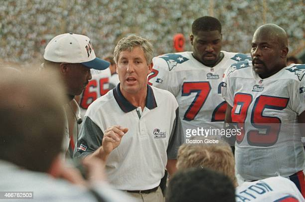 New England Patriots coach Pete Carroll talks to players during their exhibition game against the Green Bay Packers on Thursday July 31 in Green Bay...