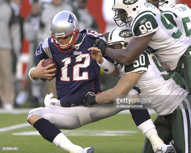 New England Patriots coach Tom Brady is sacked by the New York Jets during an NFL wild card playoff game Jan 7 2007 in Foxborough Massachusetts The...