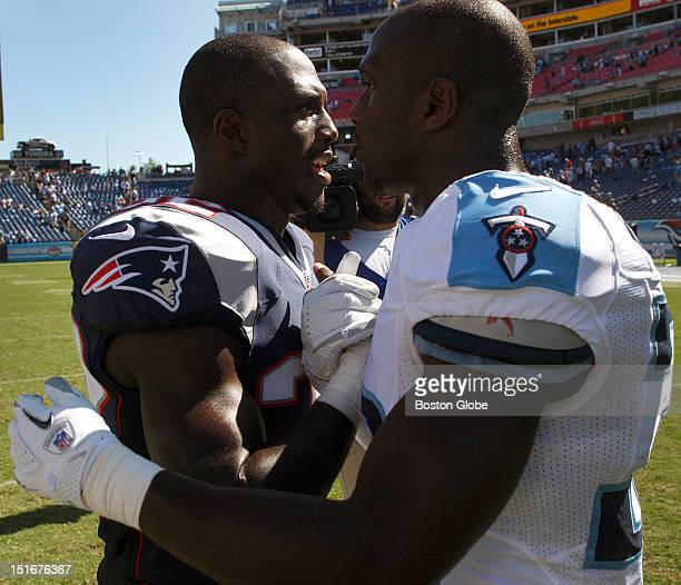 New England Patriots cornerback Devin McCourty and his brother, Tennessee Titans cornerback Jason McCourty , get together on the field after the New...