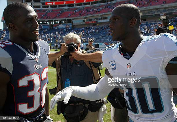 New England Patriots cornerback Devin McCourty and his brother Tennessee Titans cornerback Jason McCourty get together on the field after the the New...