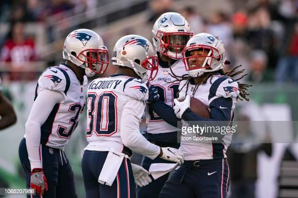 New England Patriots Cornerback Jason McCourty and New England Patriots Linebacker Duron Harmon congratulate New England Patriots Cornerback Stephon...