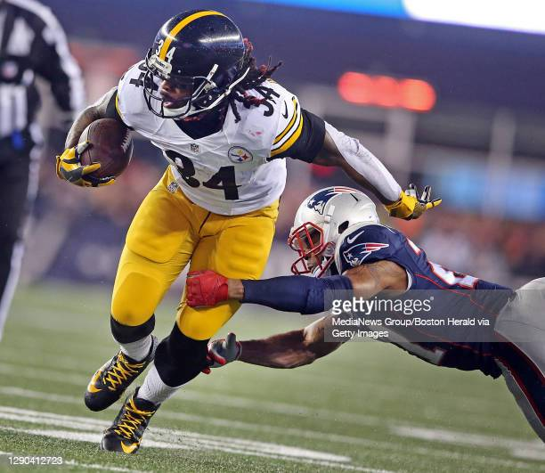 New England Patriots cornerback Malcolm Butler pulls down Pittsburgh Steelers running back DeAngelo Williams during the second quarter of the New...