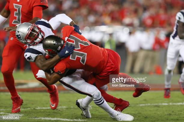 New England Patriots cornerback Malcolm Butler tackles Tampa Bay Buccaneers running back Charles Sims during the NFL game between the New England...