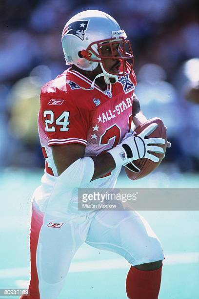New England Patriots cornerback Ty Law of the AFC returns a turnover against the NFC in the 2002 NFL Pro Bowl at Aloha Stadium on February 9 2002 in...