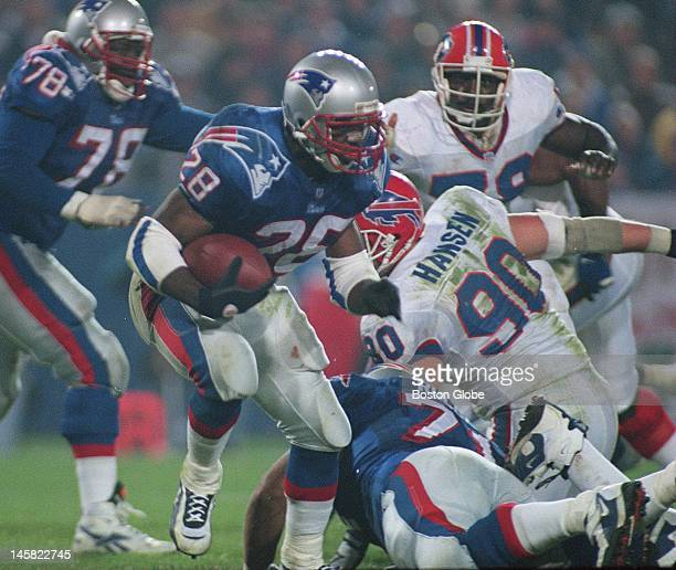 New England Patriots Curtis Martin makes his way past a block of Bills Phil Hansen by teammate Todd Rucci in the first half at Foxborough on Sunday...