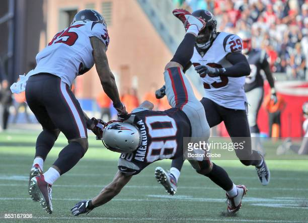 New England Patriots Danny Amendola hauls in a 27yard reception as he is ripped to the ground by Houston Texans Eddie Pleasant during the Patriots...