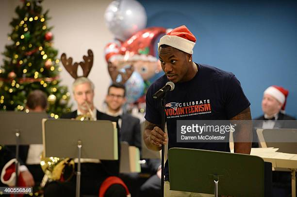 New England Patriots Darius Fleming reads Twas The Night Before Christmas with The Boston Pops at Boston Children's Hospital December 16 2014 in...