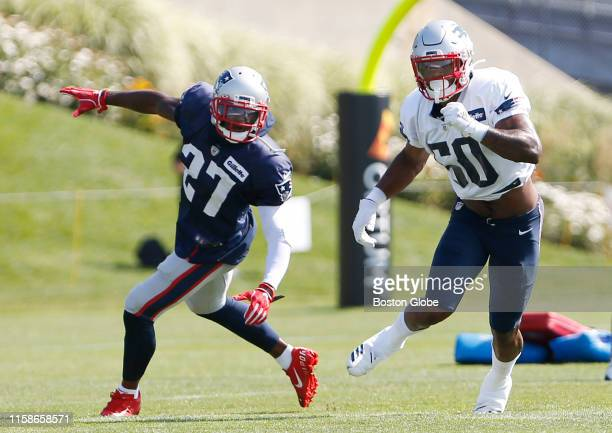 New England Patriots defensive back JC Jackson left and wide receiver N'Keal Harry run through a drill during Patriots Training Camp at Gillette...