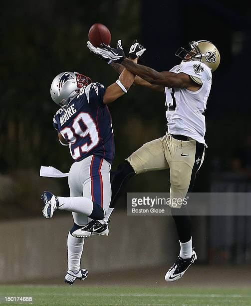 New England Patriots defensive back Sterling Moore breaks up a pass intended for New Orleans Saints wide receiver Joe Morgan during the second half...