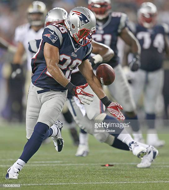 New England Patriots defensive back Steve Gregory makes an acrobatic juggling interception during the second quarter of a a preseason exhibition game...