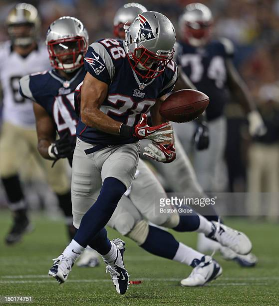 New England Patriots defensive back Steve Gregory makes an acrobatic juggling interception during the second quarter of a preseason exhibition game...