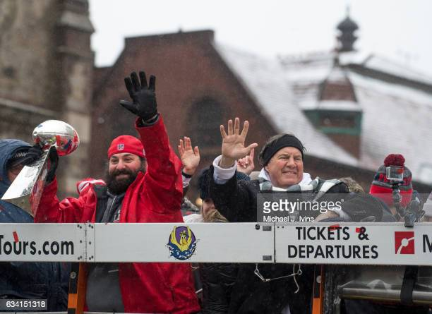 New England Patriots defensive coordinator Matt Patricia and head coach Bill Belichick wave to the crowd during a Super Bowl victory parade on...