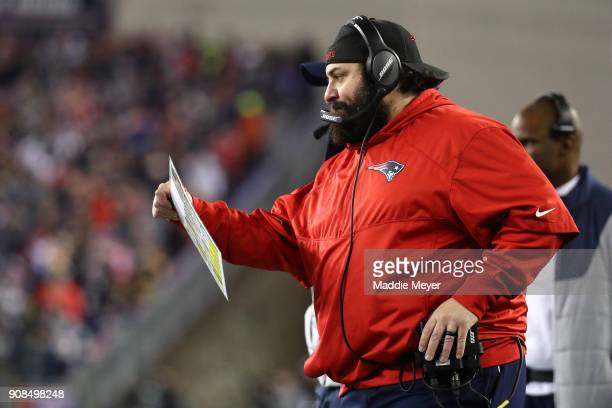 New England Patriots defensive coordinator Matt Patricia looks at a play card in the second half against the Jacksonville Jaguars during the AFC...