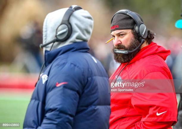New England Patriots defensive coordinator Matt Patricia talks to New England Patriots head coach Bill Belichick during a National Football League...