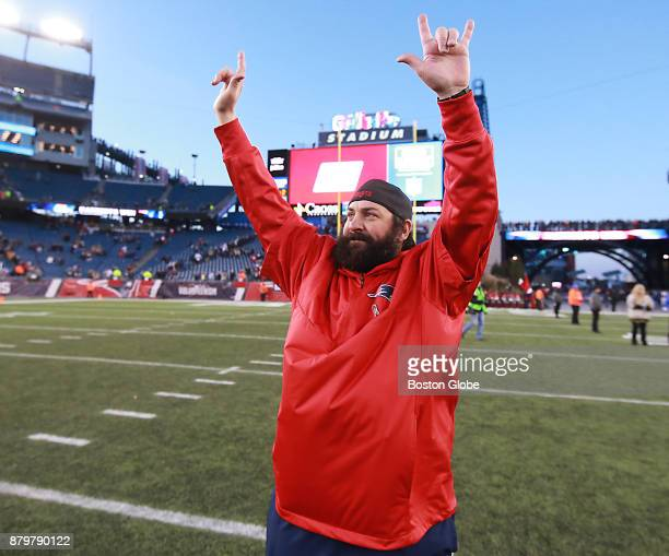 New England Patriots defensive coordinator Matt Patricia waves towards the stands after they defeated the Miami Dolphins 3417 The New England...