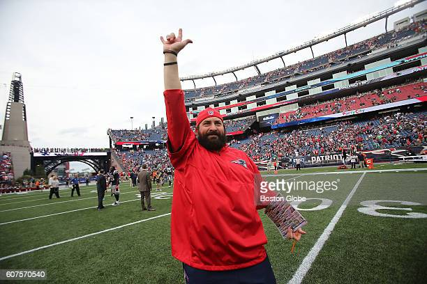 New England Patriots defensive coordinator Matt Patricia waves to the crowd after the Patriots defeated the Miami Dolphins 3124 at Gillette Stadium...
