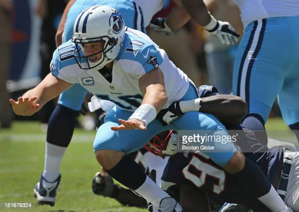 New England Patriots defensive end Chandler Jones forced a fumble by Tennessee Titans quarterback Jake Locker , which was recovered by New England...