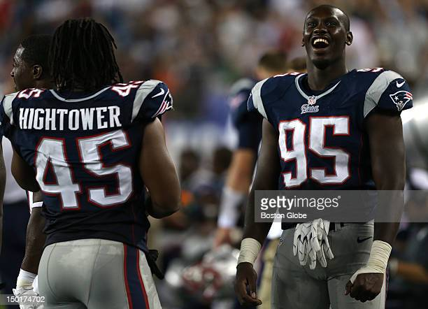 New England Patriots defensive end Chandler Jones shares a laugh with New England Patriots linebacker Dont'a Hightower late in the fourth quarter of...