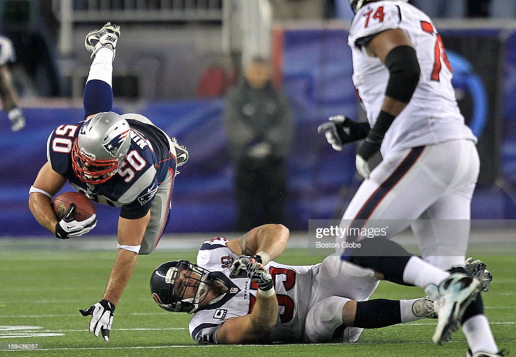 New England Patriots defensive end Rob Ninkovich (#50) takes to the air for a little extra yardage after his third quarter interception as the New England Patriots hosted the Houston Texans in an NFL AFC Divisional Playoff Game at Gillette Stadium, Jan. 13, 2013.