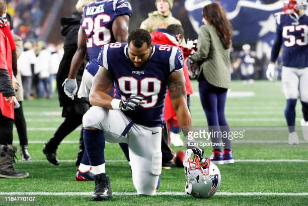 New England Patriots defensive lineman Byron Cowart prays before a game between the New England Patriots and the Dallas Cowboys on November 24 at...