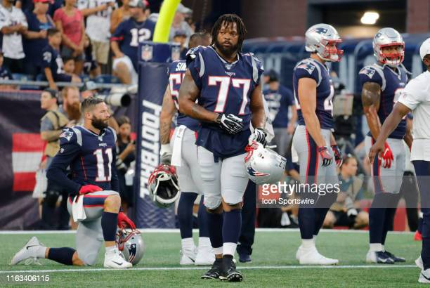 New England Patriots defensive lineman Michael Bennett waits for his turn to warm up before a preseason game between the New England Patriots and the...