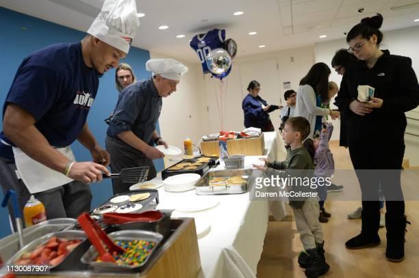 New England Patriot's Derek Rivers flip pancakes for the kids at Boston Children's Hospital March 12 2019 in Boston Massachusetts