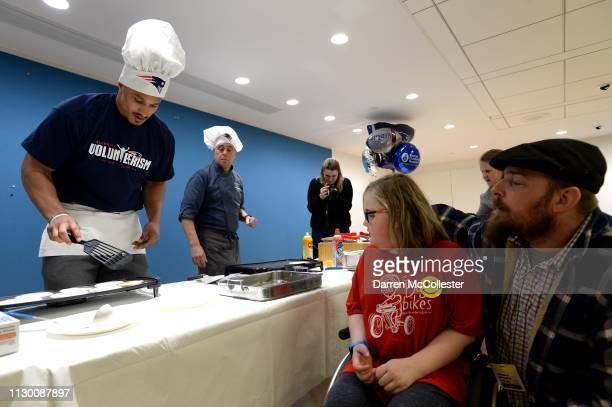 New England Patriot's Derek Rivers flips pancakes for Steven at Boston Children's Hospital March 12 2019 in Boston Massachusetts