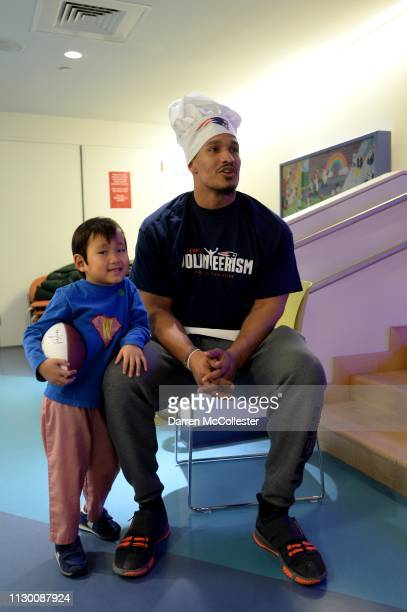 New England Patriot's Derek Rivers hangs with Will during National Pancake Day at Boston Children's Hospital March 12 2019 in Boston Massachusetts