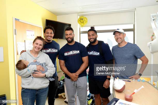 New England Patriots Derek Rivers Kyle Van Noy and Harvey Langi visit David and family at Boston Children's Hospital on May 16 2018 in Boston...