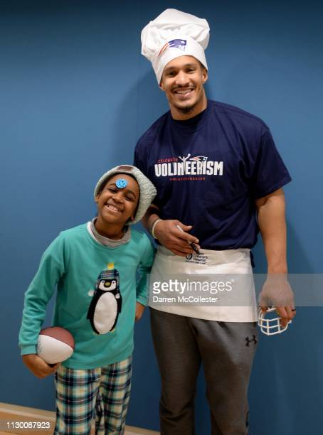 New England Patriot's Derek Rivers takes a picture with Asada at Boston Children's Hospital March 12 2019 in Boston Massachusetts