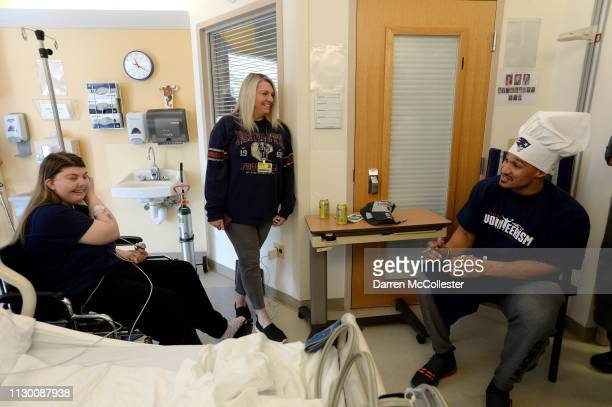 New England Patriot's Derek Rivers visits with Tessa and Mom at Boston Children's Hospital March 12 2019 in Boston Massachusetts