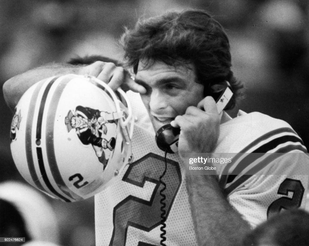 New England Patriots Doug Flutie speaks on the phone after scoring his first touchdown of the game against the Indianapolis Colts at Sullivan Stadium in Foxborough, Mass., Oct. 2, 1988.