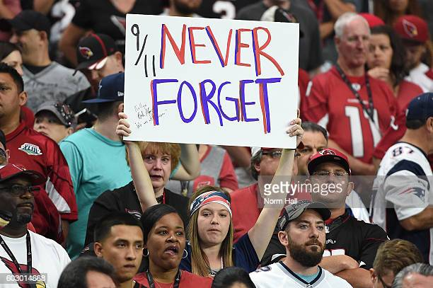 New England Patriots fan holds up a sign to honor the victims of 9/11 during the NFL game between the New England Patriots and Arizona Cardinals at...