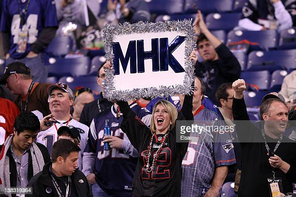 New England Patriots fan honors the passing of team owner Robert Kraft's wife Myra during warmups before the New England Patriots take on the New...