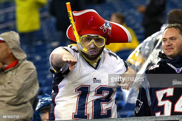 New England Patriots fan looks on while wearing a snorkel in the rain before the game against the Pittsburgh Steelers at Gillette Stadium on...