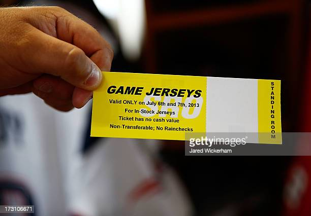 New England Patriots fan shows his voucher after trading in his Aaron Hernandez jersey during a free exchange at the pro shop at Gillette Stadium on...
