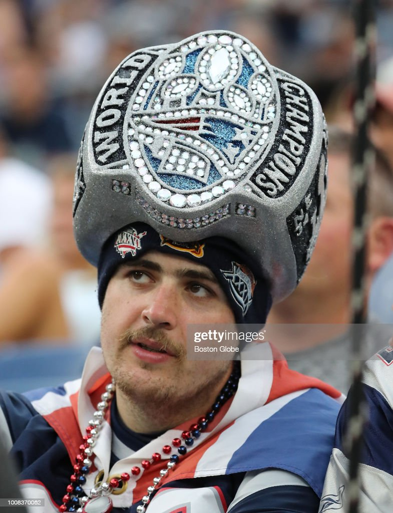 e262dc749 A New England Patriots fan wears a hat shaped like a Super Bowl ring ...
